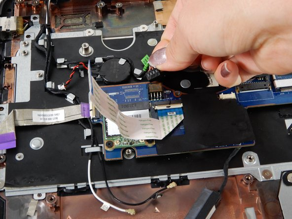 Use your hand and gently remove the connector to the back up battery for the motherboard.