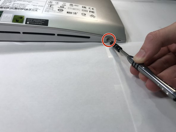 Remove the two screws on the bottom of the computer, one on each side.