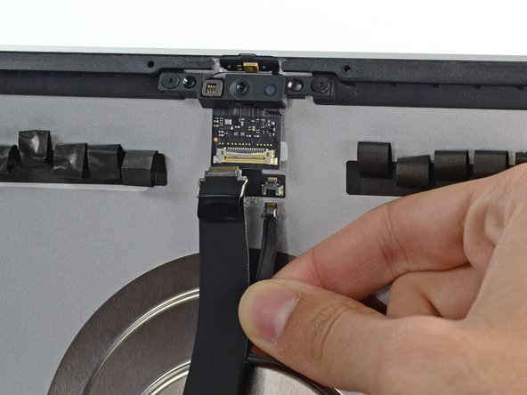 Disconnect the microphone cable from its socket.