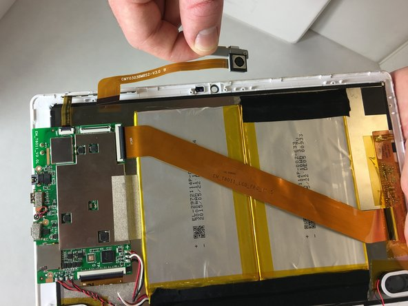 Use tweezers or your fingers to remove the camera from your Insignia Flex 10.1 NS-P16AT10.