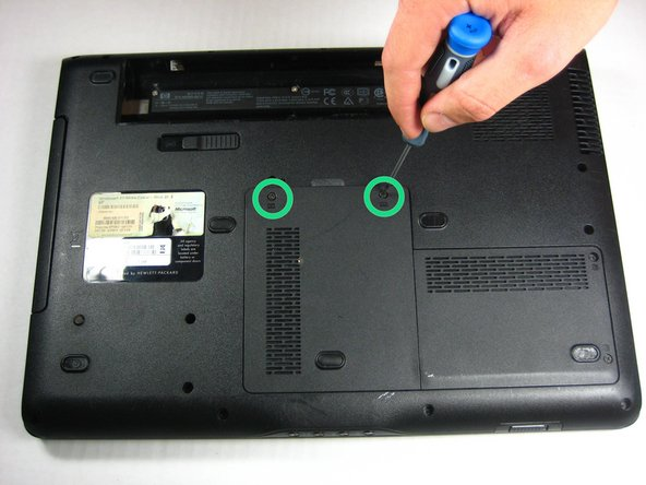 Remove the two screws from the memory shield and lift up.  The screws will remain into the shield