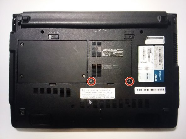 Locate the two screws on the ram panel.