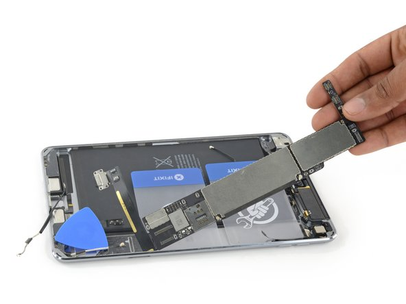 Remove the logic board assembly from the rear case.
