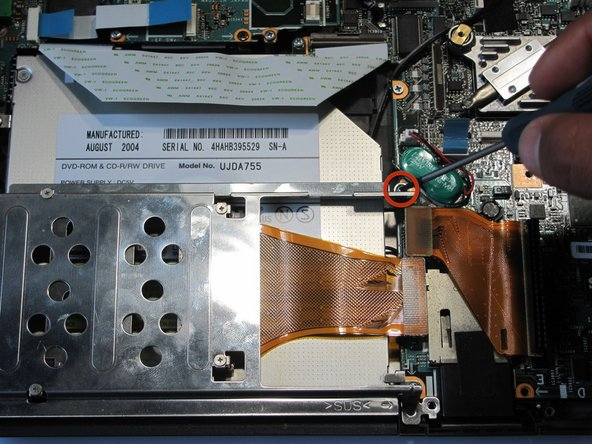 Locate the screw holding the optical drive casing to the logic board