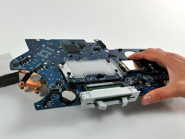 Image 1/1: Be sure to only handle the logic board by its edges.