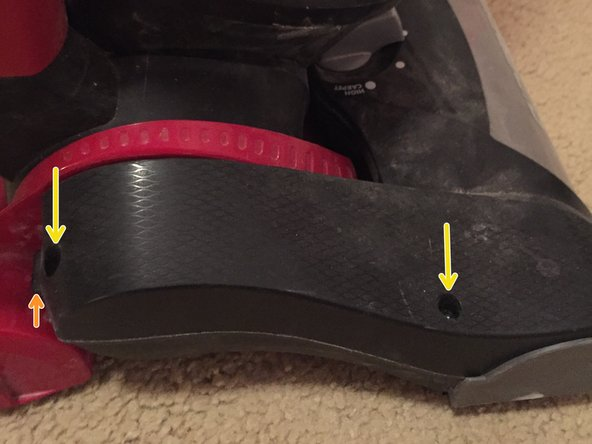 Image 1/1: Remove the cover from the vacuum.