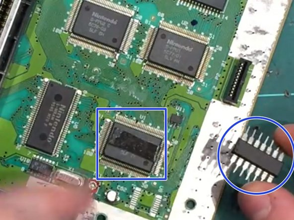 Use double sided tape and put it on top of the CPU and put the Super CIC on top of the double sided tape.