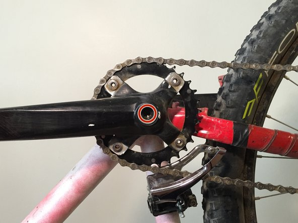 Take out the bolts on the base of the crank using an allen wrench that fits the bolt.