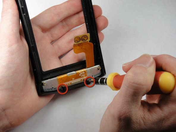 Use a T5 Torx screwdriver to remove the 7.75mm screws at the bottom of the device.
