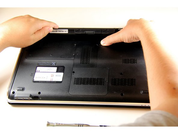 Image 2/2: To prevent hardware damage, remove the battery before working on the laptop.