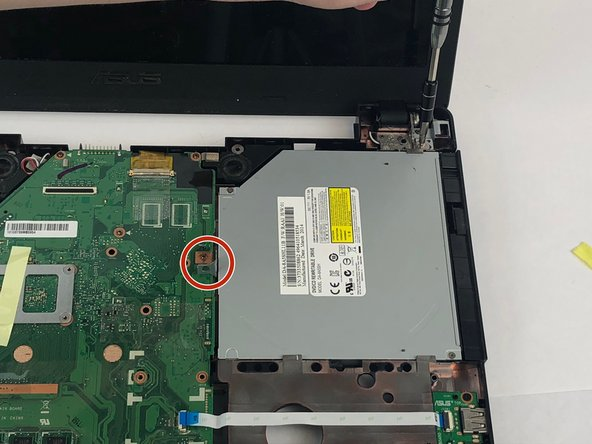 Ensure the screw keeping the disc drive in place is removed, then slide the drive out