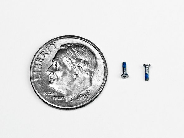 Image 2/2: Both the Phillips and Pentalobe screws are really small. How small? See for yourself (highlighted in the second picture).