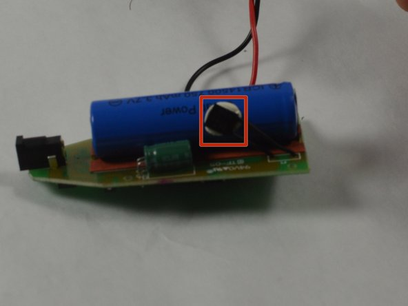 Remove the thermal switch from the battery by using the spudger to pry it from the adhesive.