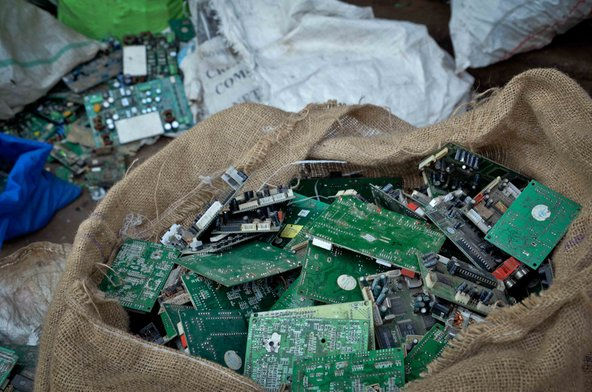A sack of used electronics and e-waste