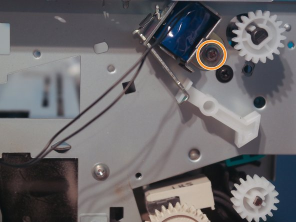 Remove one screw holding down the duplexer solenoid.