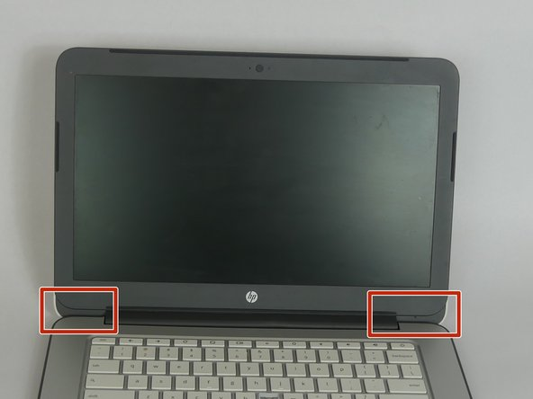 Remove lower left and right nylon flaps on the screen to remove the screws located underneath them.