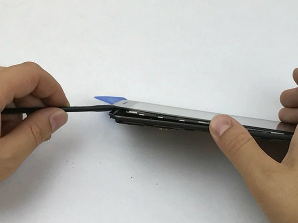Once the majority of the adhesive is removed, gently lift the screen using the opening tool or the spudger.