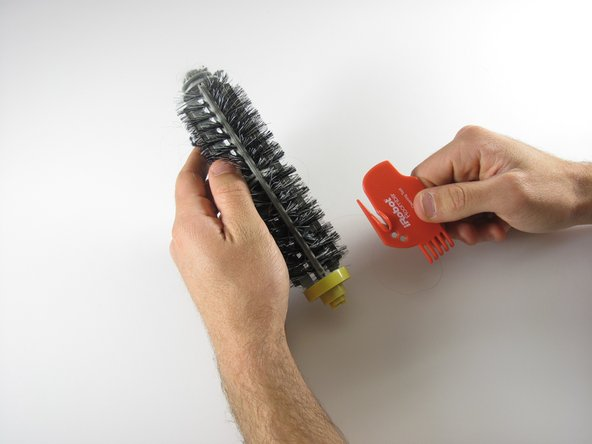 Image 1/3: Slide the brush cleaner down and back up until your brush is clean
