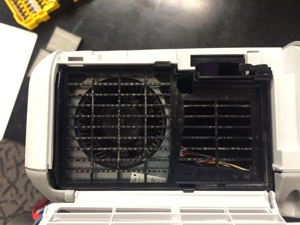 Be sure to leave the filter door open as it will hold the projector case closed if it is closed.