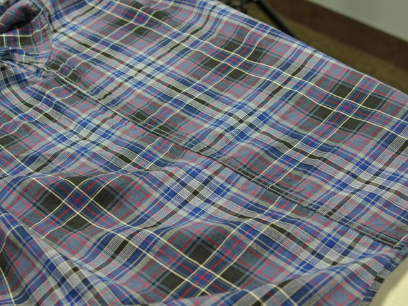 Lay your wrinkly fabric or garment onto the ironing table.