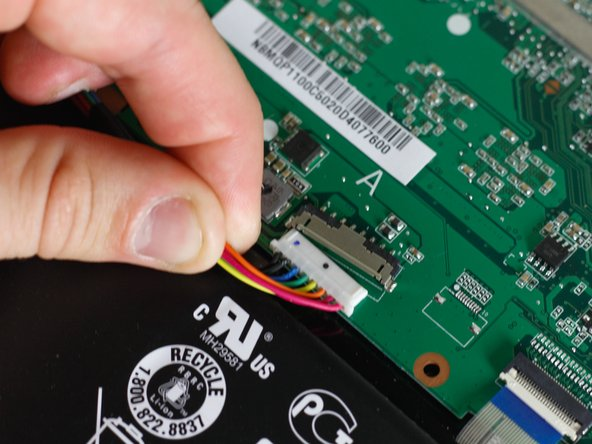 Disconnect the battery from the motherboard by simply pulling the wires down towards the battery until the adapter dislodges.