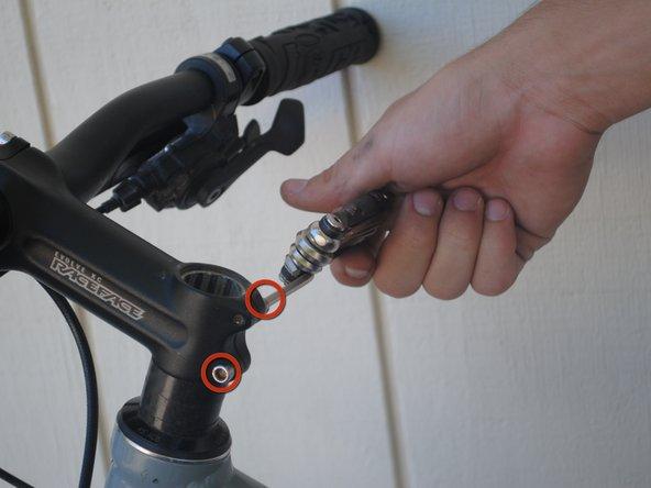 Image 2/3: Lift off the handlebar.