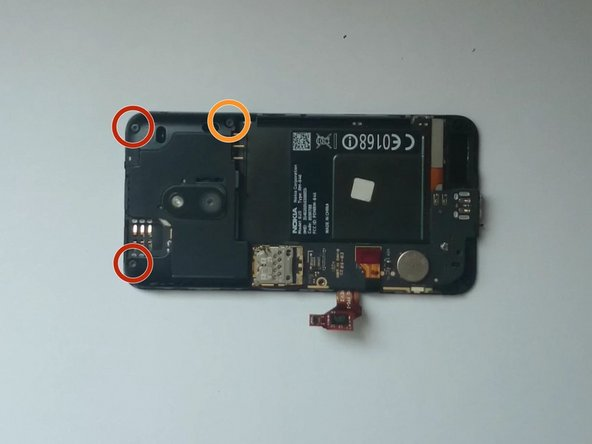 Image 1/3: Disconnect the Touch screen and the Digitizer flex cables.