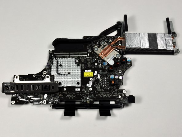 Image 1/2: The ports are all soldered directly to the logic board, and connect at a slight angle to fit the curvature of the iMac's rear housing.