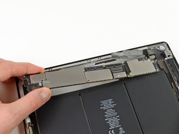Holding the logic board by the side nearest the dock connector, carefully pull the logic board toward the bottom of the iPad.