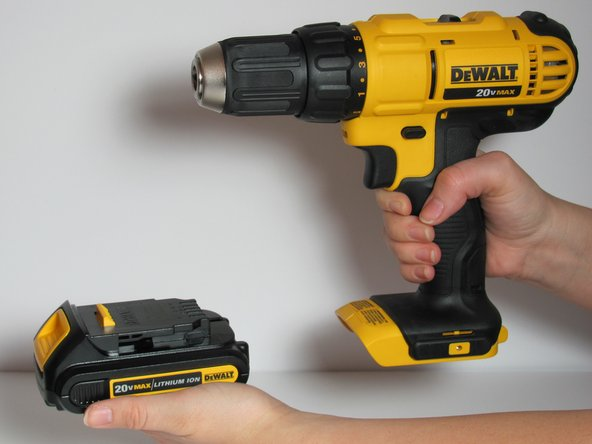 Pull the battery in a horizontal direction away from the drill.