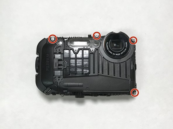 Using the H1.3 hex head bit, remove the four screws on the front of the camera.