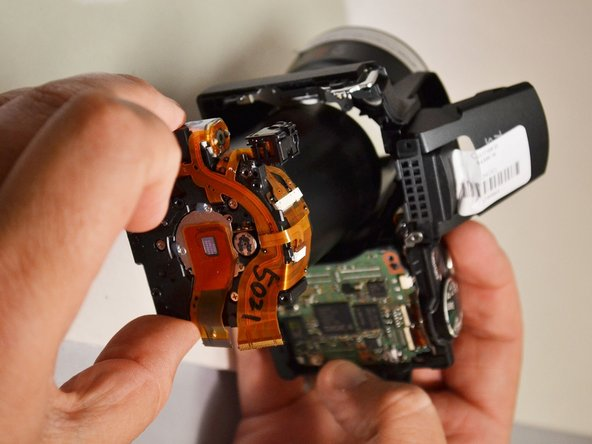 Remove the lens from the lens shaft       (Lens is removed from camera).