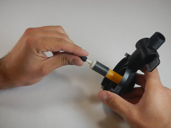 Remove the rubber stop that is attached to the tube that runs through the middle of the impeller.