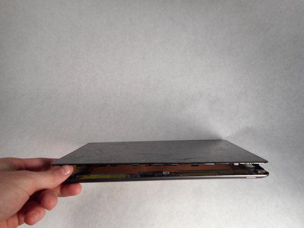 Now that the screen is completely detached, lay the back panel flat on a smooth surface.