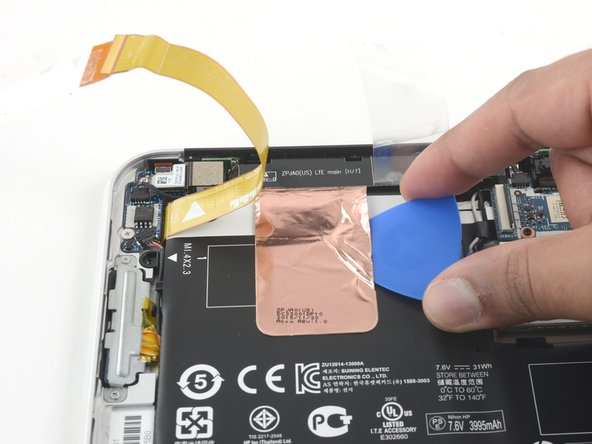 And then peel away four more pieces of tape that run over and around the battery.