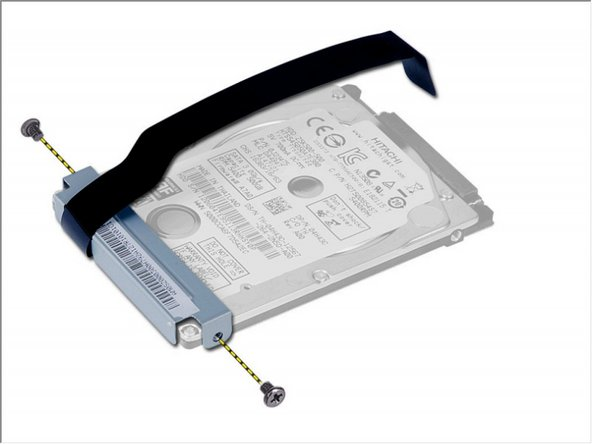 Remove the screw that secures the hard-drive caddy to the hard drive and remove it.