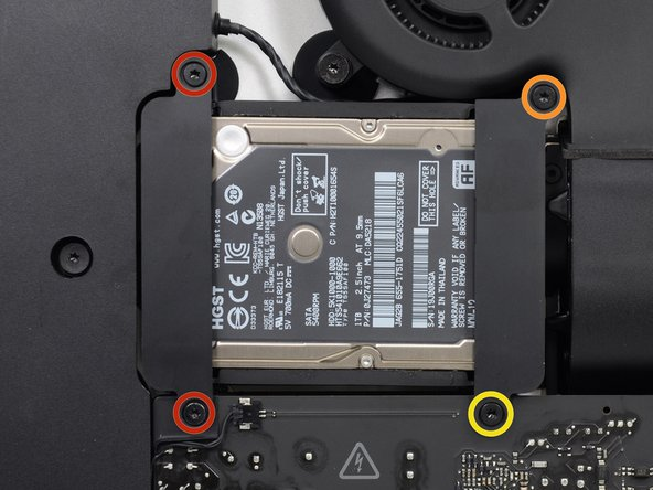 Remove the following screws securing the hard drive bracket to the rear enclosure: