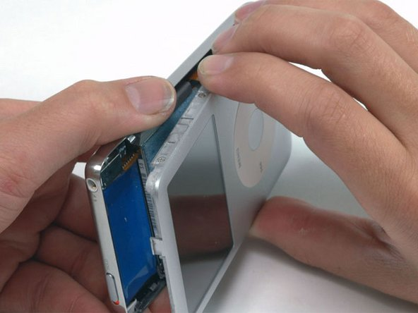 There are two ribbon cables connecting the rear panel to the rest of the iPod. In the following step, be careful not to damage these ribbon cables.