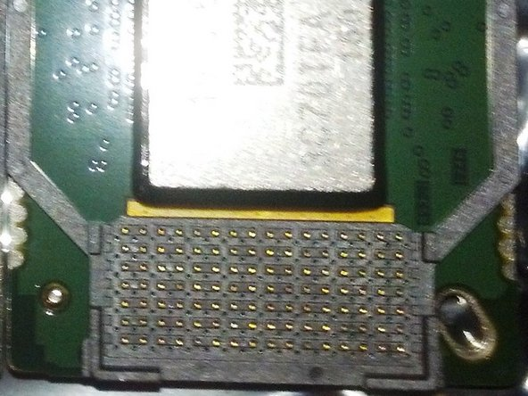 lay the new chip in the socket, lining up the plastic edges of the chip with the plastic guides of the socket.