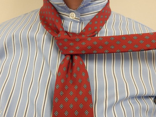 Wrap the active end over the wide end of your tie.