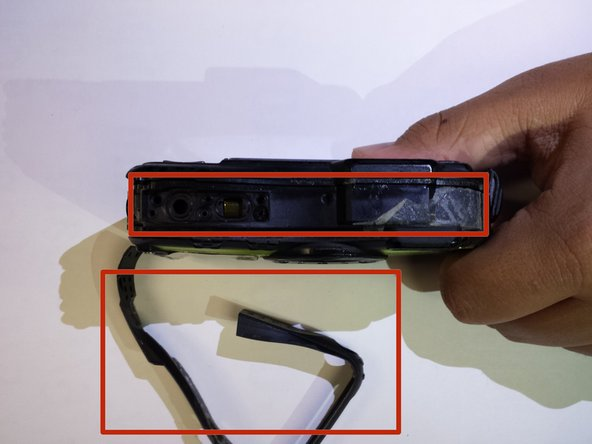 Remove the black rubber adhesive around the border of the device by peeling slowly.