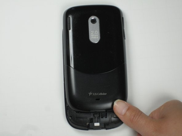 Next, using both thumbs, carefully push the back side of the phone's exterior up, removing it from the main section of the phone.