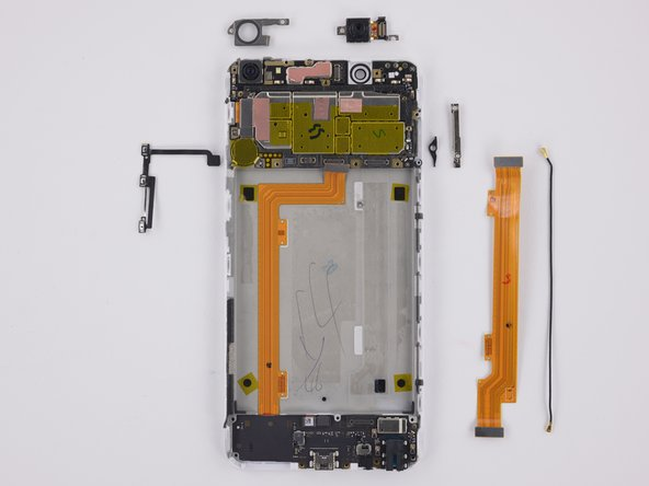 The next layer of components out are: Interconnect cable, antenna interconnect cable, button cable, brackets, SIM eject lever, and front facing camera.