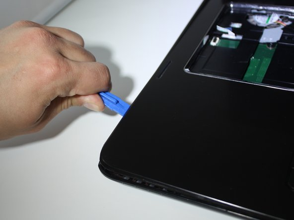 Do not proceed without holding the laptop screen/lid for support. The screen is very heavy and may cause the device to fall if not held and supported.