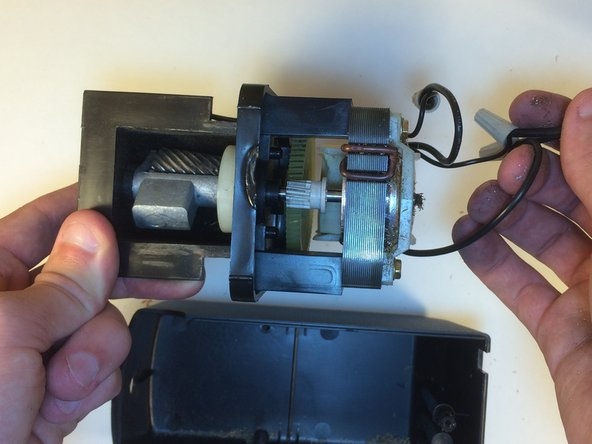 Carefully move the wires so that the case can be completely removed.