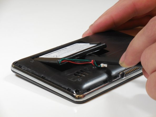 Use the plastic spudger to lift the battery up and away from the device.