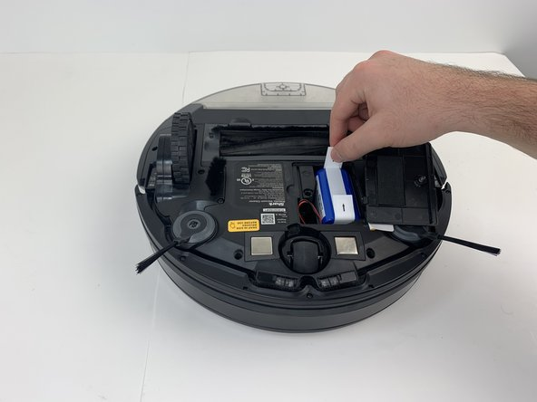 Be careful when removing the battery, as it will still be connected to a wire.