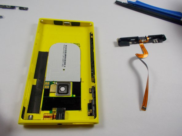 Image 3/3: Completely remove the plastic piece from the back panel shell.