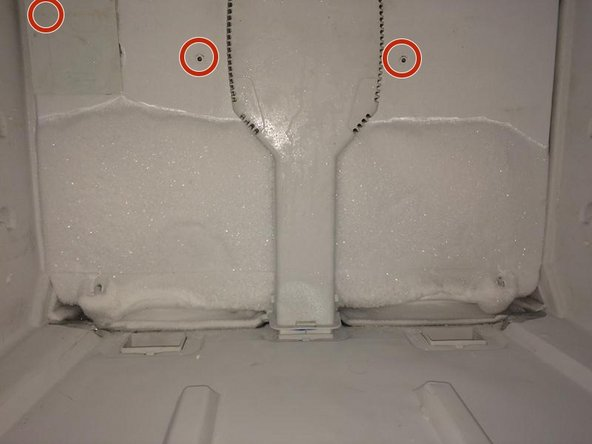 "Remove the cover from the evaporator by removing the three 1/4"" screws."