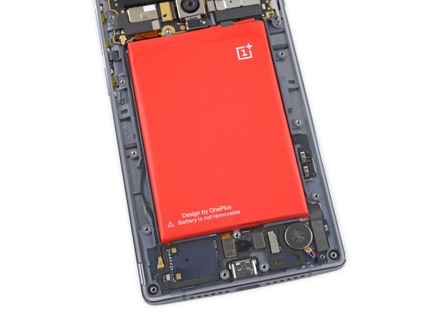 Image 1/3: The ''not-removable'' battery makes a pretty red target for our grabby teardown hands.